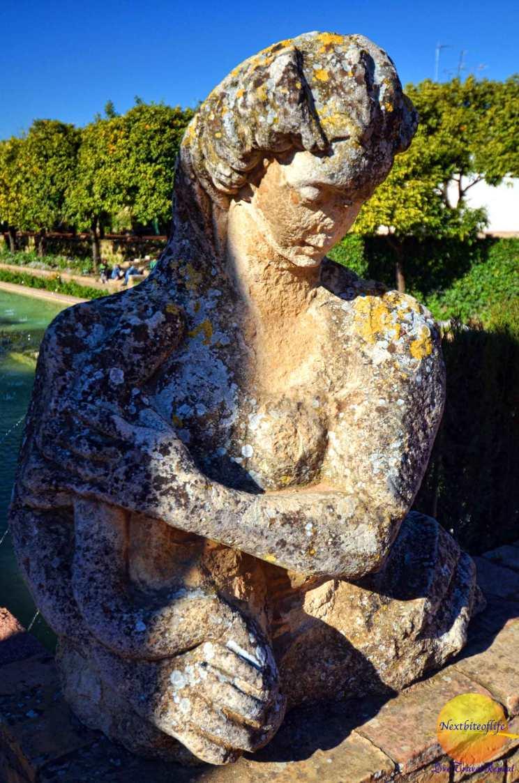 statue at cordoba alcazar gardens