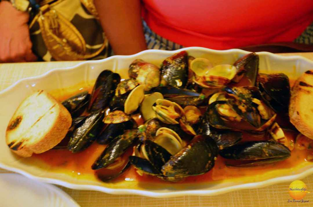 Seafood marinara sauce and mussels plate bologna italy