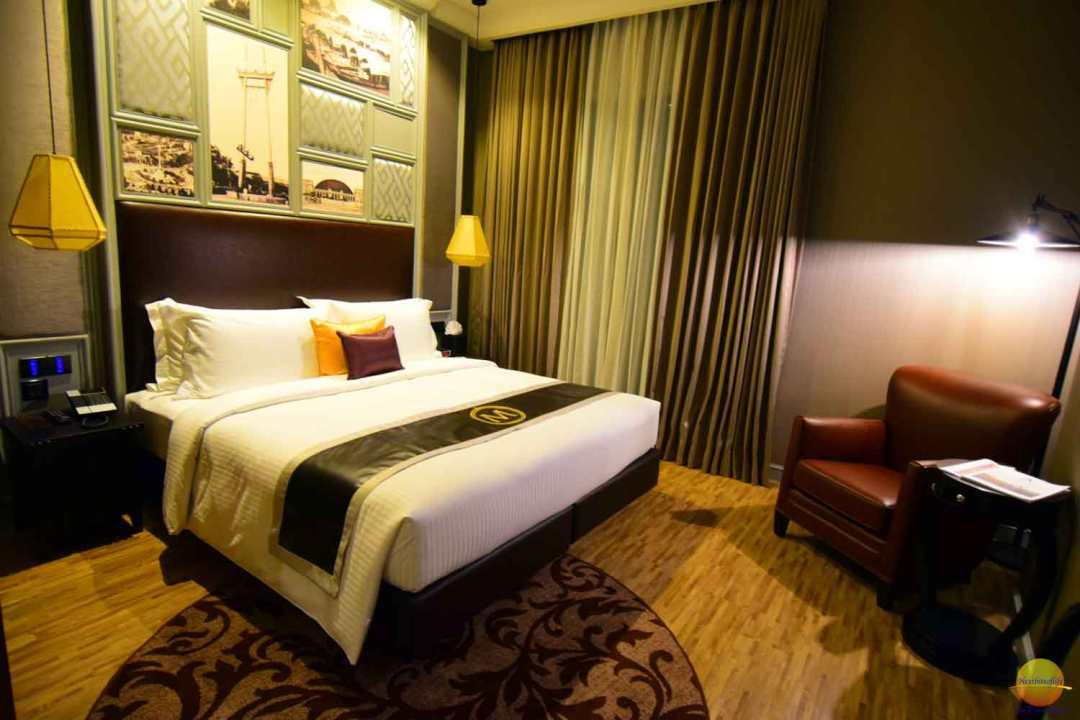 Metropole Bangkok understated luxury bed