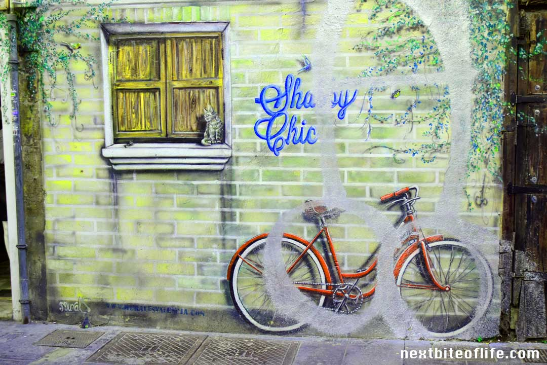 graffiti valencia spain red bike in wall