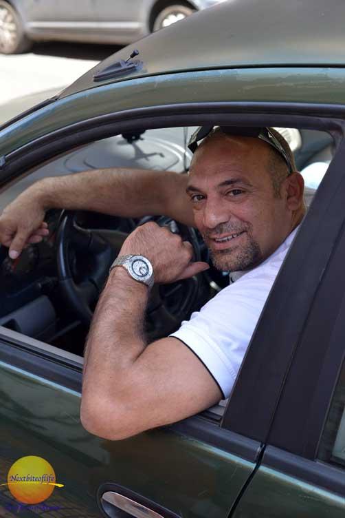 greek man in car athens greece