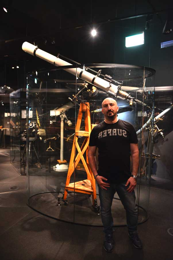man in front of telescope national museum prague