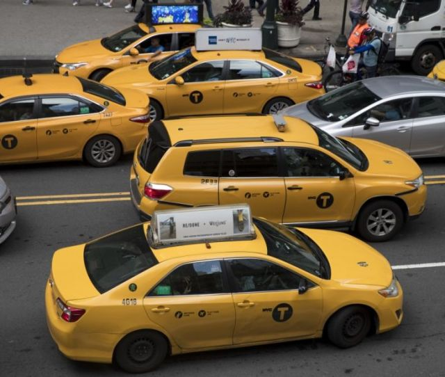 In This Wednesday Aug 1 2018 Photo Yellow Cabs Make Their Way Across 42nd Street Outside Grand Central Terminal In New York