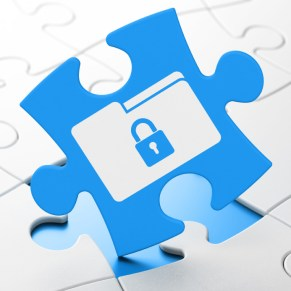 Business concept: Folder With Lock on puzzle background