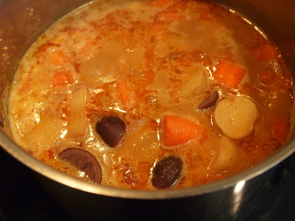 onion, potatoes, and carrots simmering