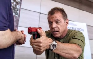 Tony Blauer holding SIRT and discussion firearm training.