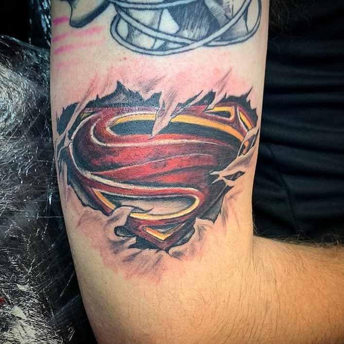 Ripped Skin Superman Tattoo -shel_tattoos