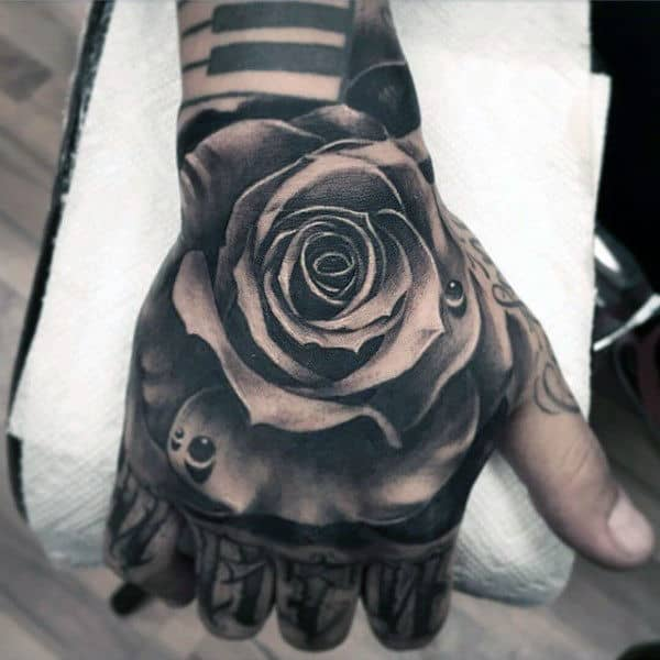20 Detailed Hand Tattoos Rose Ideas And Designs