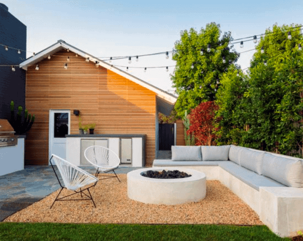 Luxury Gravel Patio With Fire Pit And String Lights