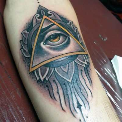 Male Forearms Yellow Eyed Illuminati Tattoo