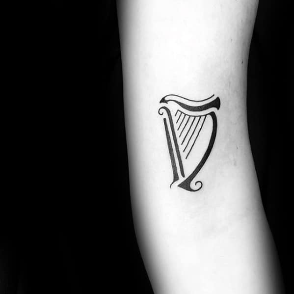 """D'abord on boit, ensuite on discute""  Minimalist-small-forearm-mens-harp-tattoo-designs"