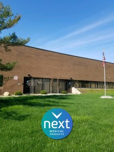 Front of building with American flag for NEXT Medical Products Company in Branchburg, NJ