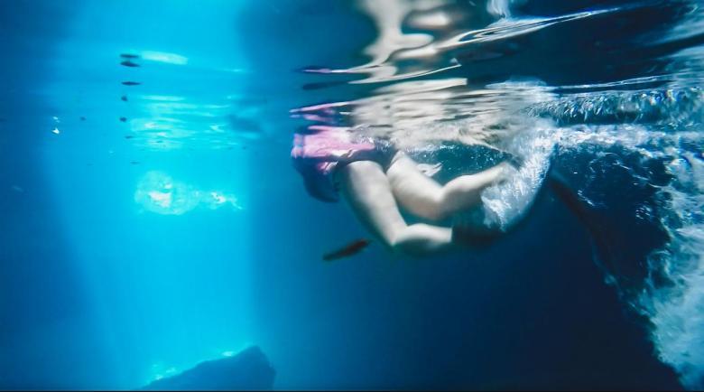 snorkeling in an underwater spring cave
