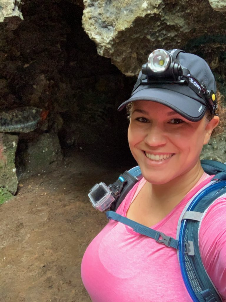girl hiker wearing headlamp