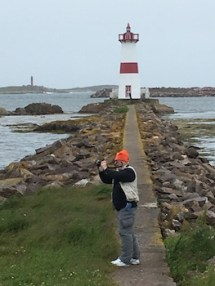 me taking photos of dad taking photos in front of the lighthouse