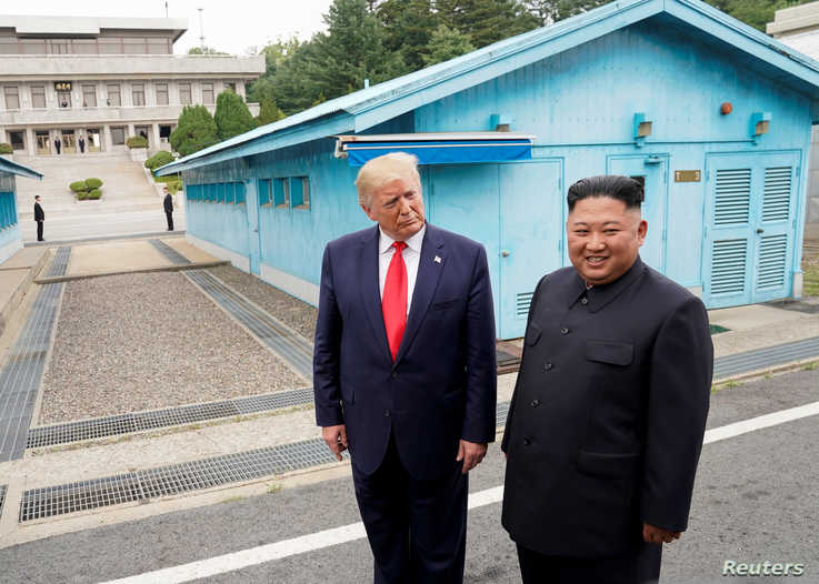 FILE PHOTO: U.S. President Donald Trump meets with North Korean leader Kim Jong Un at the demilitarized zone separating the two…