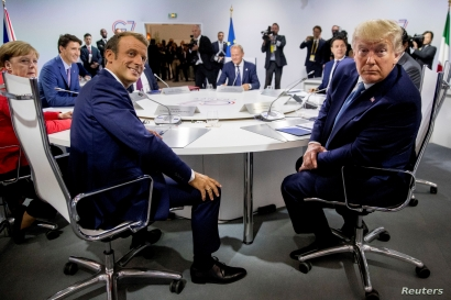French President Emmanuel Macron and President Donald Trump participate in a G-7 Working Session on the Global Economy, Foreign Policy, and Security Affairs at the G-7 summit with German Chancellor Angela Merkel, Canadian Prime Minister Justin Trudeau and President of the European Council Donald Tusk in Biarritz, France, August 25, 2019.