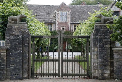 A gate protects the entrance of the Rooksnest estate near Lambourn, England, Tuesday, Aug. 6, 2019. The manor is the domain of Theresa Sackler, widow of one of Purdue Pharma's founders and, until 2018, a member of the company's board of directors. A…