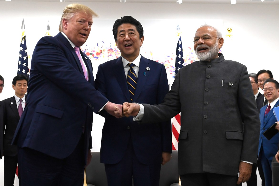 President Donald Trump, Japanese Prime Minister Shinzo Abe and Indian Prime Minister Narendra Modi share a fist bump during their meeting on the sidelines of the G-20 summit in Osaka, Japan, Friday, June 28, 2019. (AP Photo/Susan Walsh)
