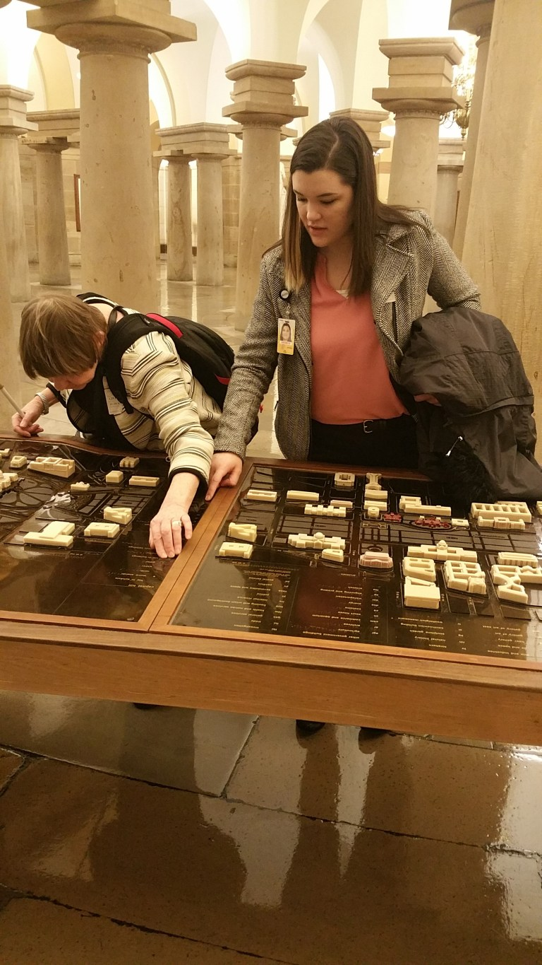 Dana Ard explores a 3-D tactile map with braille of the Washington D.C. area, allowing her to feel important buildings and their relationships to one another