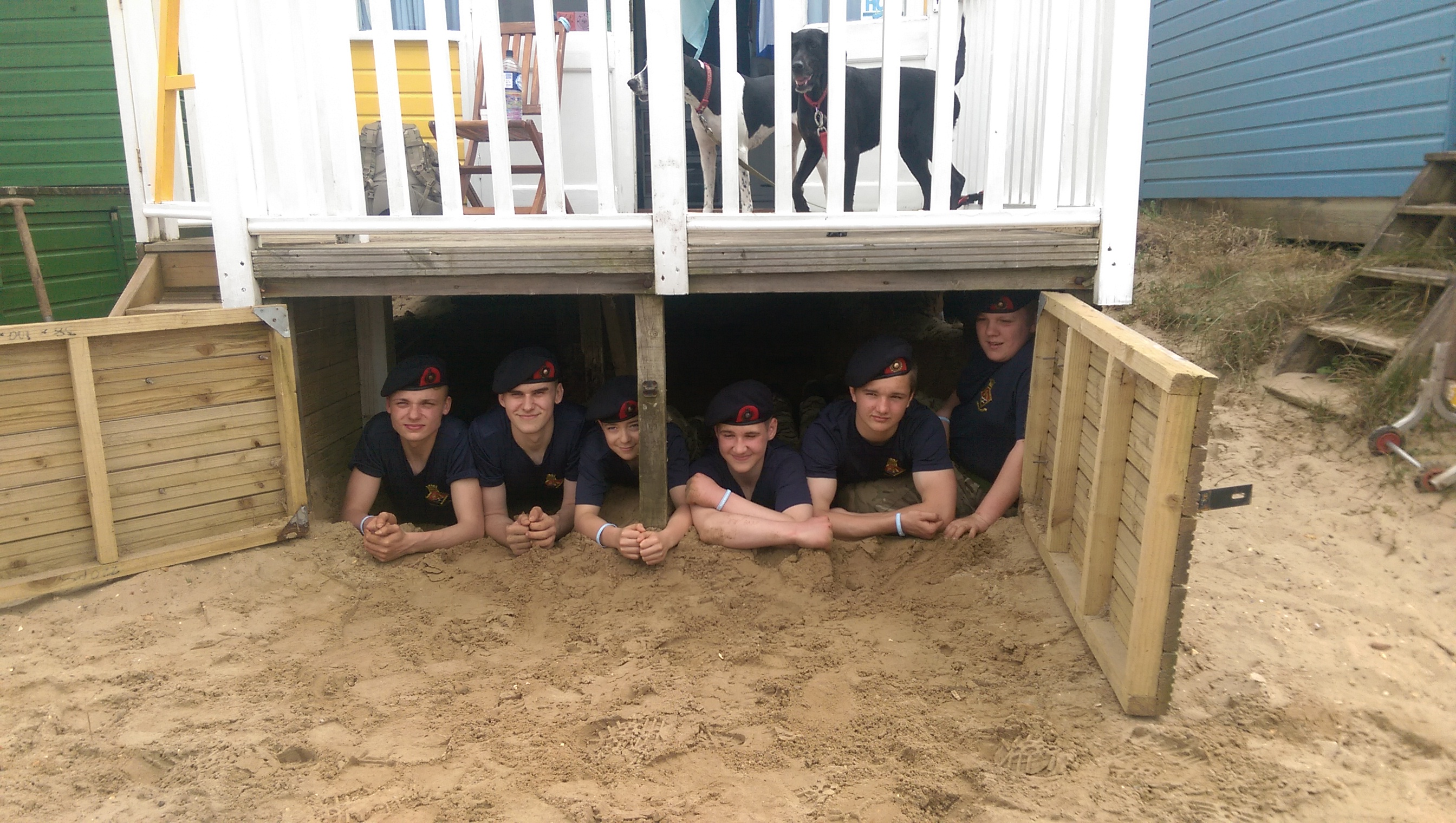 Cadets laying under decking.