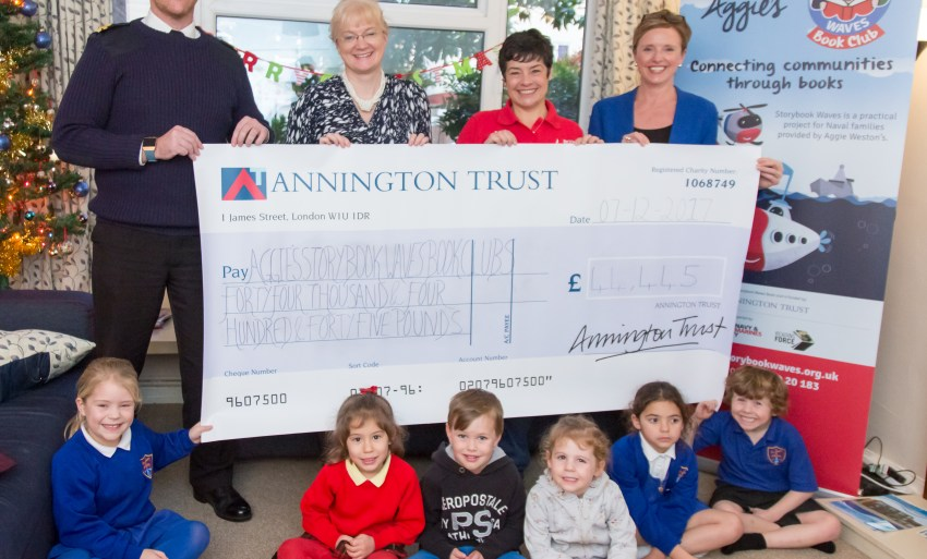 Storybook Waves cheque presentation, children and teachers smiling while receiving it.