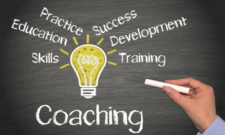 Lightbulb with coaching buzzwords written around it.