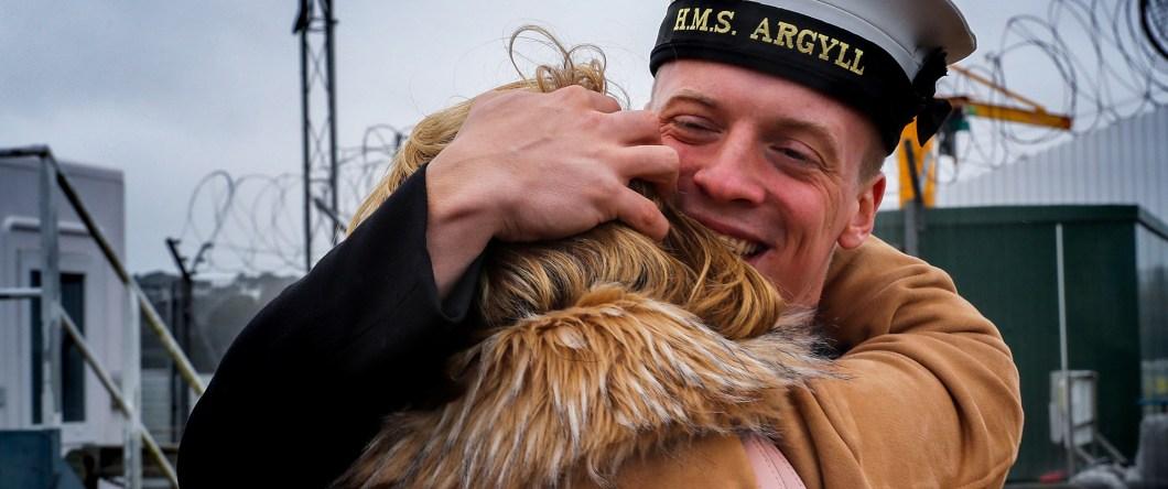 HMS Argyll sailor hugging.
