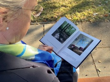 Image of Anna (NFF CEO) reading the 'Time, On My Watch' book.