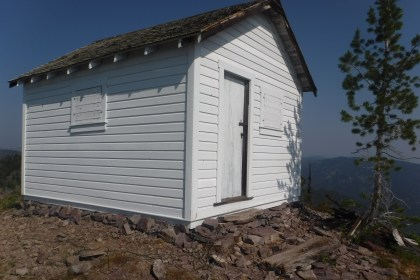 The newly sided historical Coal Ridge Cabin; it was painted white like it was back in the 1930's