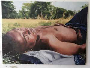 Painting of young black man lying in a field