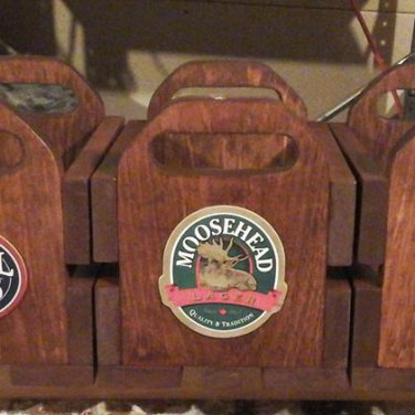 Visit Handcrafted by Melissa for beer crates. They are designed to hold two growlers of your favourite beer!