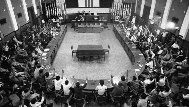 A joint session of South Vietnam's National Assembly votes on Sunday, April 28, 1975 to ask President Tran Van Huong to turn over his office to Gen. Duong Van Minh. The assembly made a move in the 11th hour to attempt to negotiate a settlement with the Communist forces. (AP Photo/Errington)