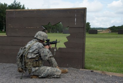 "All Guard International Combat Team Member, Army Sgt. Steven Fletcher, Virginia Army National Guard, fires during the Advanced Fleeting Encounter Assessment June 25, 2016 at Army Training Centre Pirbright, Woking, England. This assessment required him to engage moving targets while moving to various locations to maintain cover and concealment while firing. (""Released"" Photo by: 2nd Lt. Memory Strickland, 119th Mobile Public Affairs Detachment, and cutline by: Capt. Theresa Walker, U.S. National Guard Marksmanship Training Center)"