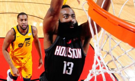 Harden of the Rockets dunks on the Jazz defenders