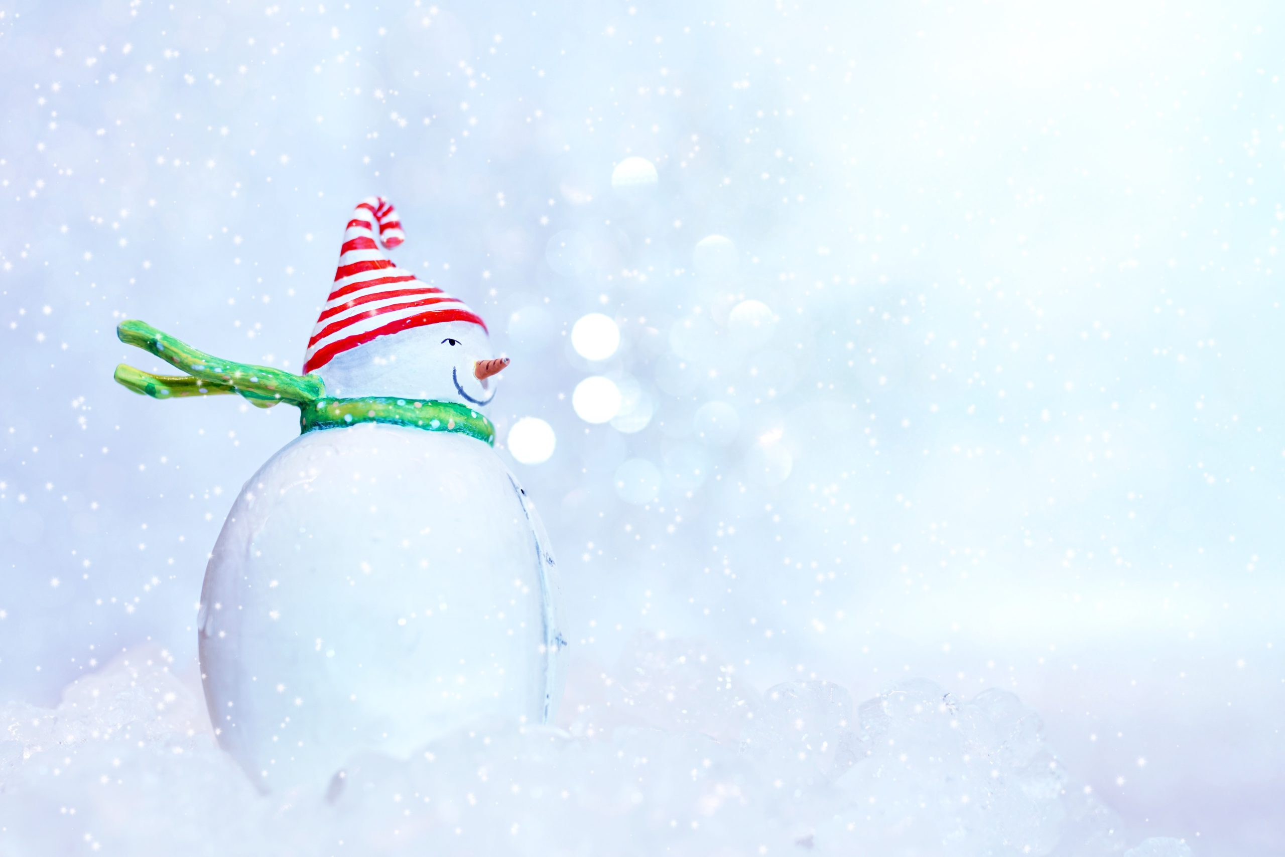 Snowman with red hat and green scarf