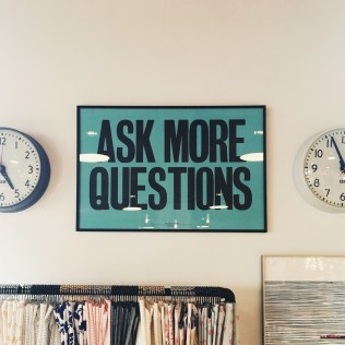 Sign on office wall: Ask More Questions