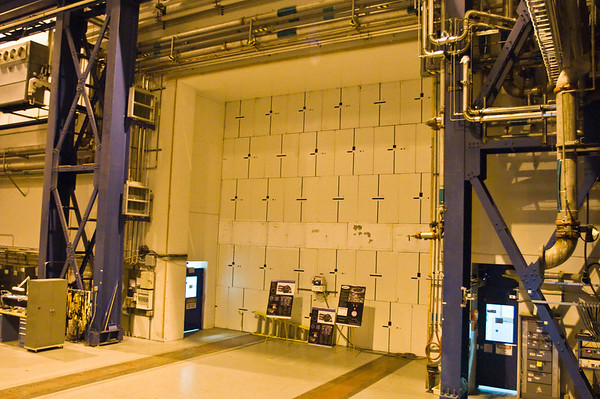 Two beams of particles, accelerated to relativistic speeds, race around intersecting rings. Behind this enormous wall lies the STAR detector, placed at one of two points where the two beams collide.