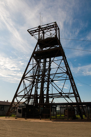The metal structure supporting the double-decker cage elevator that descends into the mine