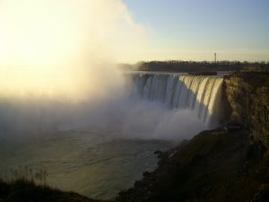 Sun Shining Through the Mist at the Horseshoe Falls by Andrew Porteus