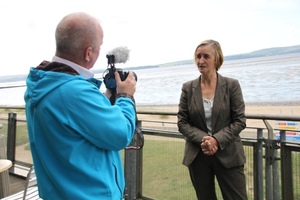 Nia Griffith MP being interviewed at Llanelli beach by Llanelli Herald reporter Alan Evans.