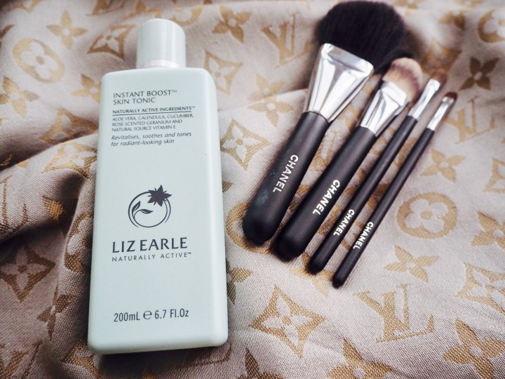 Liz Earle Instant Boost Skin Tonic with a selection of Chanel makeup brushes
