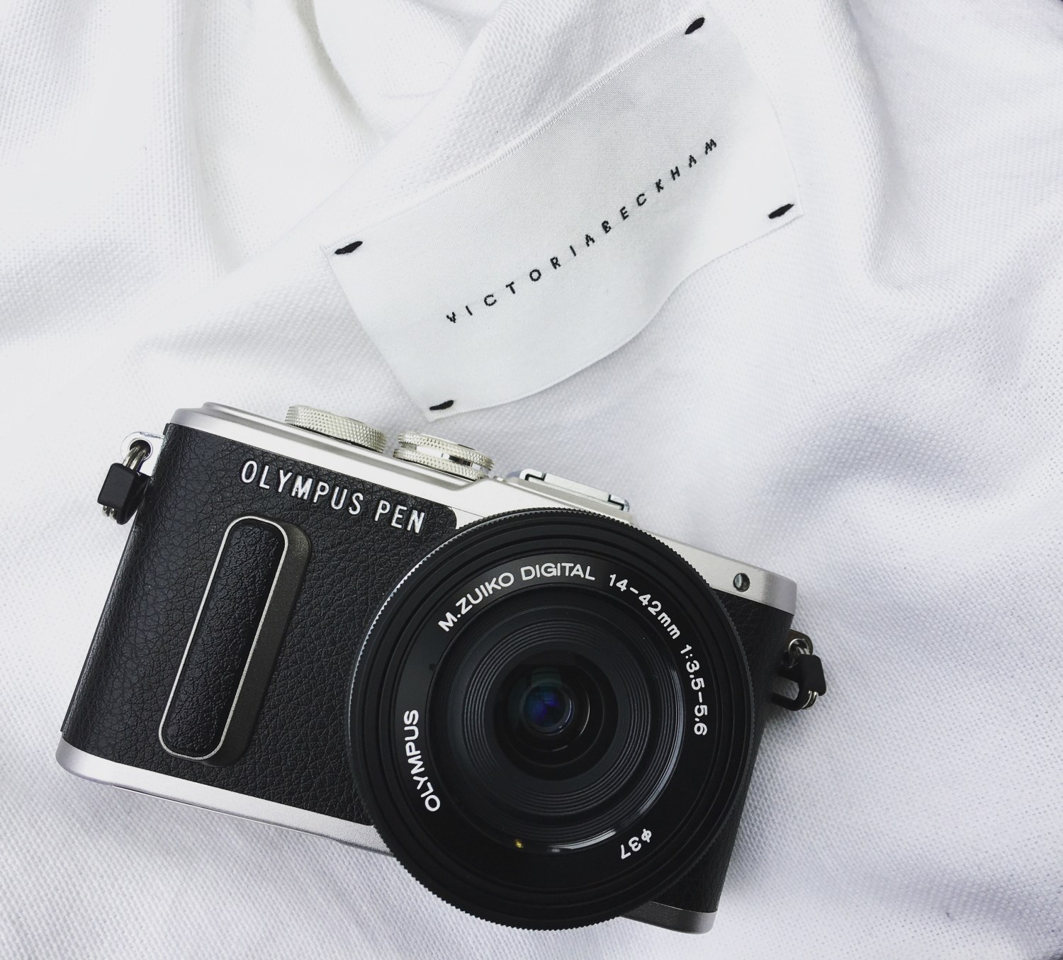 Olympus Pen E-PL8 camera on a Victoria Beckham dust bag