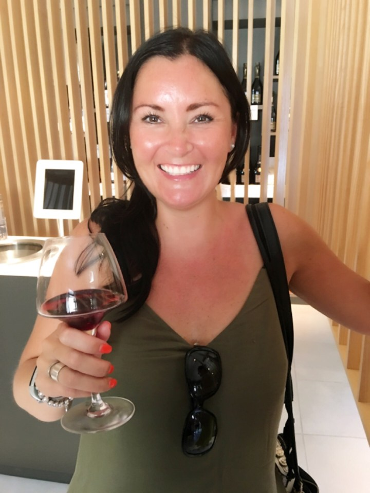 Girl holding a glass of wine celebrating