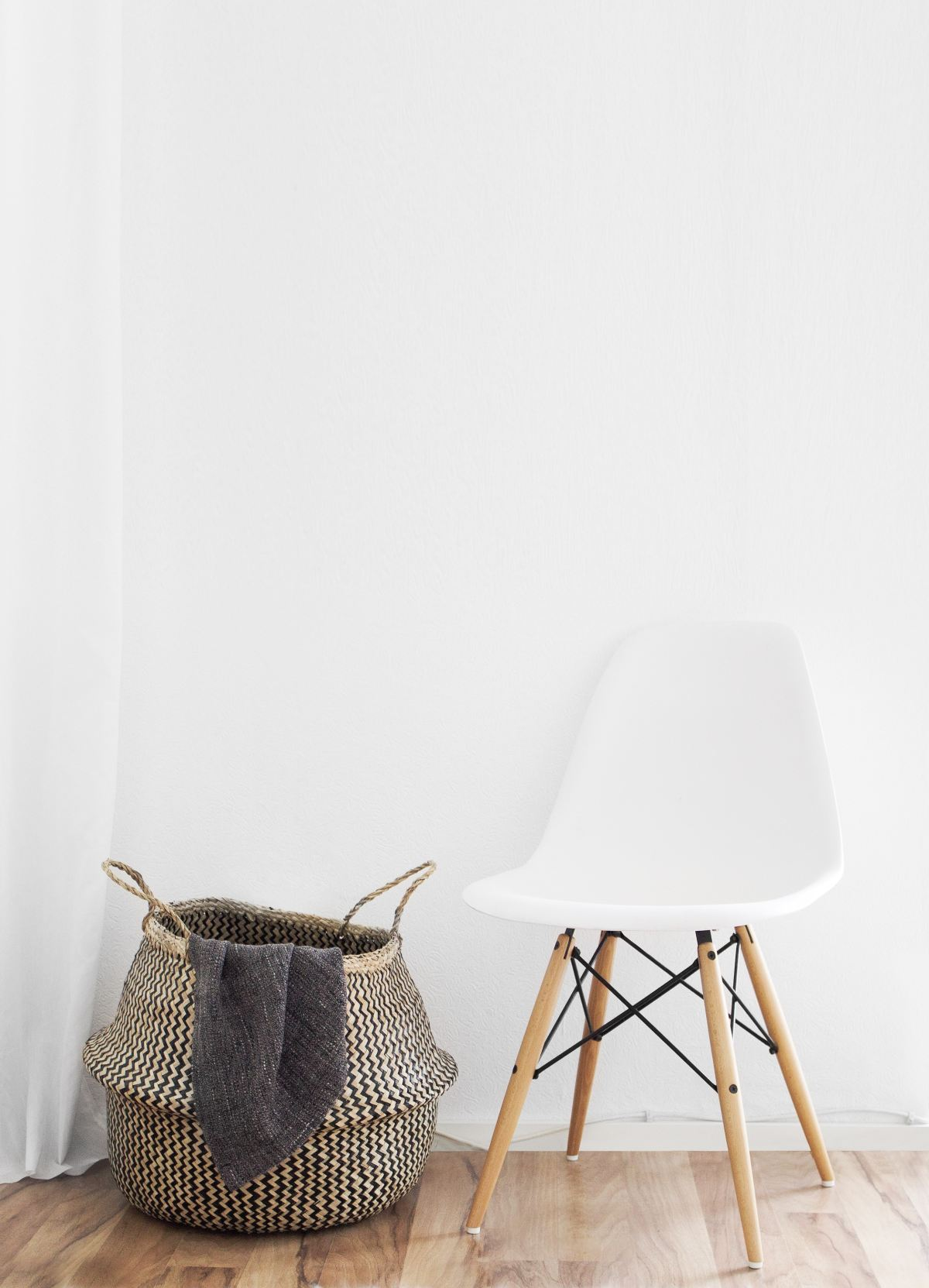Picture of a white modern chair and basket