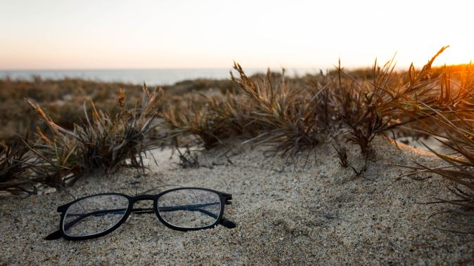 Photo of glasses on a beach
