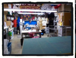 View of the width of the sewing room - I told you it was large - proper cutting table, sewing machine and serger tables and the pressing table ...