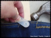 Place your loaded Jeans button gizmo on your jeans and tap with your hammer (took me about 7 or 8 taps to secure it properly).