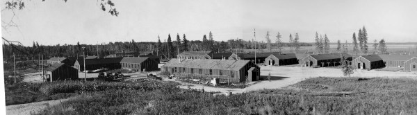 A general view of the Riding Mountain Park Labour Project. These permanent structures included bunkhouses (rear right), a guardhouse (foreground), kitchen and mess hall, a recreation hall, a garage, stables, and a barn.