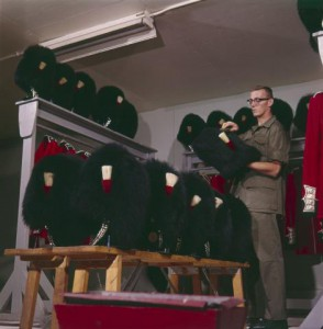Canadian Guard brushing bearskin hat, 1961. Source: LAC. Item K-5866. Box TCS 01186.